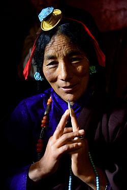 Tibetan pilgrim on kora, a sacred pilgrimage around Gonchen Gompa / Derge Monastery, portrait. Derge, Garze Tibetan Autonomous Prefecture, Sichuan, China. 2016.