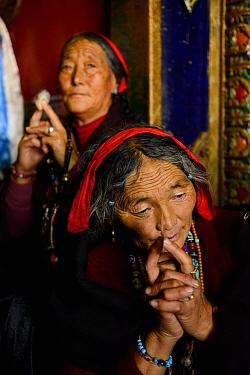 Tibetan pilgrims making kora, a sacred pilgrimage around Gonchen Gompa / Derge Monastery. Derge, Garze Tibetan Autonomous Prefecture, Sichuan, China. 2016.