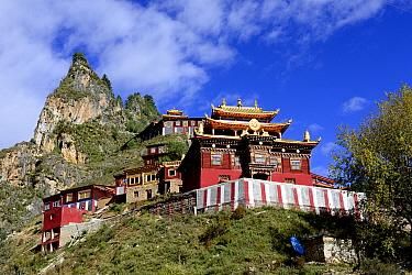 Palpung Monastery below mountain peak. Kham, Dege County, Garze Tibetan Autonomous Prefecture, Sichuan, China. 2016.
