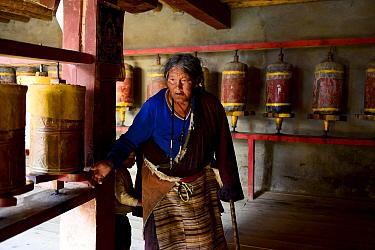 Tibetan Buddhist pilgrim in Ganden Thubchen Choekhorling Monastery. Litang, Garze Tibetan Autonomous Prefecture, Sichuan, China. 2016.