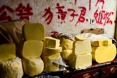 Yak (Bos grunniens) butter on stall at Tibetan market. Litang, Garze Tibetan Autonomous Prefecture, Sichuan, China. 2016.