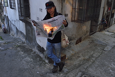 Man reading 'Hot news' Zhan Jiang city, Guangdong, China November 2015.