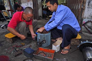 Generator repair shop in the street, Xia Shan area in the Zhan Jiang city, Guangdong, China, November.