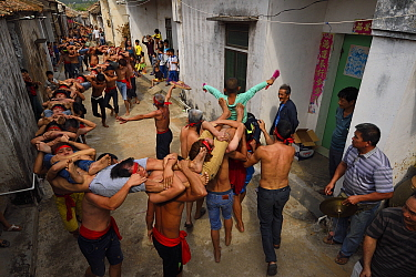 The Human Dragon, a traditional dance performance festival event for the New Year celebrations, Sheng Tang village, Guangdong province, China
