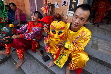 The traditional Nuo dance, or Lion Dance, performed during New Years festival, in the Song Zhu Toan village, Guangdong province, China
