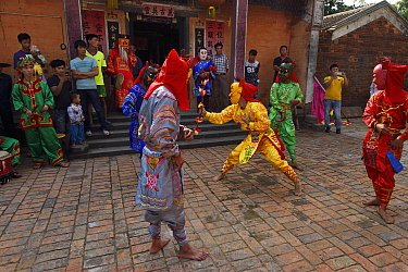 Traditional Nuo dance, or Lion Dance, performed during New Years festival, in the Song Zhu Toan village, Guangdong province, China