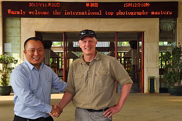 Photographer Staffan Widstrand with the hotel director at Hot spring resort in Xu Wen, Guangdong province, China