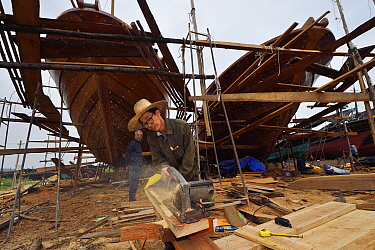 Shipyard for building and renovation traditional wooden fishing boats, in the fishing harbour of Wai Luo Gang, Guangdong province, China November 2015.