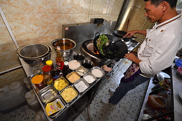 Restaurant cooking lunch meal, Xu Wen, Guangdong province, China November 2015.