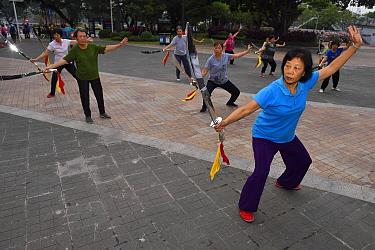 Morning Tai Qi Qigong in the park, Guangzhou, Guangdong, China November 2015.