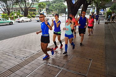 Joggers in the morning, Guangzhou, Guangdong, China November 2015.