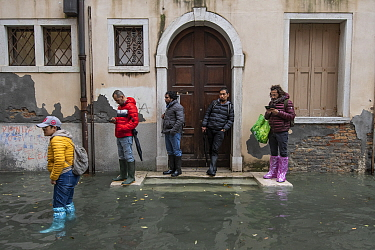 People waiting outside hose during flooding in Venice, Italy, December 2019.