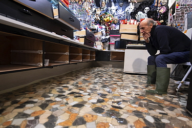 Worried Venetian shop owner during Flooding in Venice, Italy, December 2019.