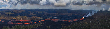 Composite aerial view of Kilauea Volcano east rift zone erupting hot lava from Fissure 8 in the Leilani Estates subdivision near the town of Pahoa during the summer 2018 eruption. The lava drains down...