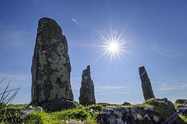 Sun above Glengor Standing Stones, Glengorm Estate, Isle of Mull, Scotland, UK. June 2013.