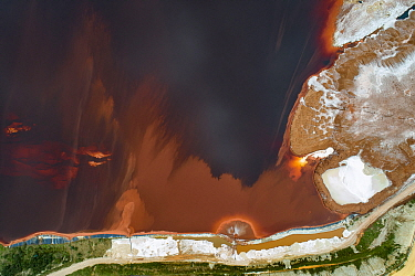 Aerial view of red mud / alumina deposits, where with a highly alkaline waste product produced by the industrial production of aluminium is stored. Located on seashore in Galicia, Northern Spain.