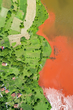 Aerial view of red mud deposits in storage pond. A highly alkaline waste product produced by the industrial production of aluminium at factory 5 miles away. Bosnia and Herzegovina.  Locals have said...