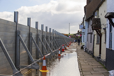Flood defences holding back River Severn floodwaters along street in Bewdley. The river overtopped the barriers after Storm Ciara and Storm Dennis, the wettest February recorded in the UK. Worcestersh...