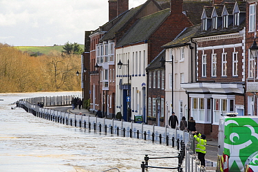 Flood defences alongside flooded River Severn, river overtopped the barriers. After Storm Ciara and Storm Dennis, the wettest February recorded in the UK. Bewdley, Worcestershire, England, UK. Februar...