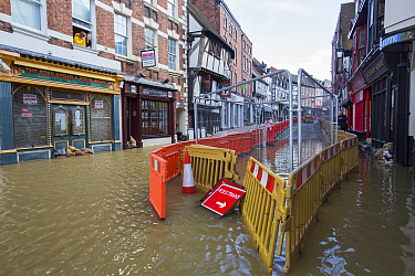 Shops in town centre flooded by River Severn. After Storm Ciara and Storm Dennis, the wettest February recorded in the UK. Shrewsbury, Shropshire, England, UK. February 2020.