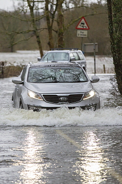 Car driving through flood caused by Storm Ciara. Rothay Bridge, Ambleside, Lake District, UK. February 2020.