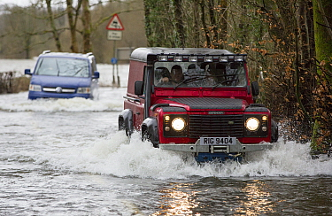 Land Rover driving through flood caused by Storm Ciara. Rothay Bridge, Ambleside, Lake District, UK. February 2020.