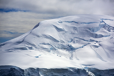 Snow covered mountainside with avalanche debris. Two Hummock Island, Palmer Archipelago, Antarctica. January 2020.