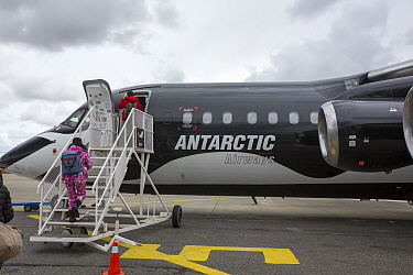 Tourists boarding plane during Antarctic tourism trip from Punta Arenas, Chile. South Shetland Islands, Antarctica. December 2019.