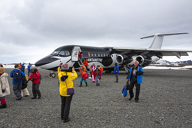 Tourists landing at Frei Station during Antarctic tourism trip from Punta Arenas, Chile. King George Island, South Shetland Islands. December 2019.