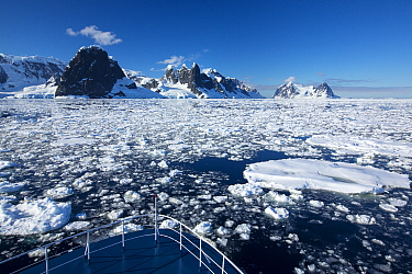 Peaks on the side of Lemaire Channel between Booth Island and Kiev Peninsula, view above from bow of expedition cruise ship. Antarctica. December 2019.