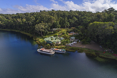 Tea House restaurant in rainforest at edge of Lake Barrine, aerial view. Crater Lakes National Park, Wet Tropics of Queensland, Australia. 2017.