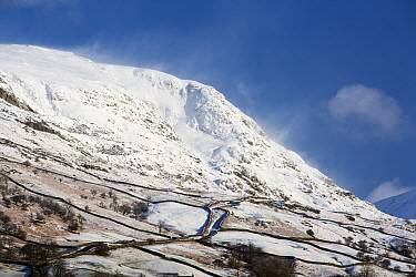 Snow covered hillside. Red Screes, Lake District National Park, England, UK. February 2020.