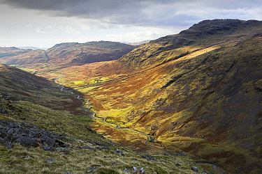 Moorland view through Duddon Valley towards Cockley Beck, Wrynose Pass alongside meandering river. Lake District National Park, Cumbria, England, UK. November 2019.