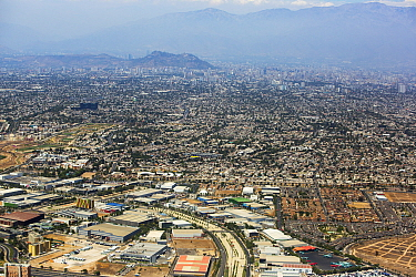 City of Santiago with airport in foreground, aerial view. Chile. December 2019.