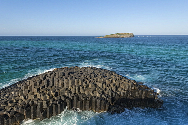 Columnar basalt rock at Fingal Head, extends underwater to Cook Island. New South Wales, Australia. 2018.