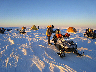 Nomadic field camp on the ice cap, packing the skidoos, Antarctica January 2007