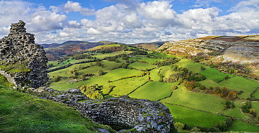 View looking looking north west from the ruined walls of Castell Dinas Bran with the Eglwyseg escarpment on the right and Llantysilio Mountain in the background North Wales, UK. October 2019.