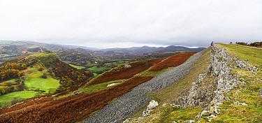 Dinas Bran Castle and the Eglwyseg Escarpment, beds of Dinantian age carboniferous limestone. Vale of LLangollen, Denbighshire, Wales, UK. November 2018.