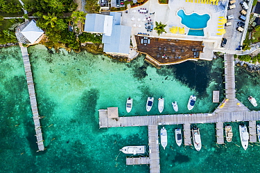 Hotel with marina constructed in a seagrass bed, aerial view. Harbour Island, Bahamas. 2019.