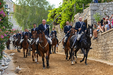 Men on horseback participating in Alka procession, spectators observing from side. Held on the first Sunday in August since 1715 the Alka commemorates the victory of Christians over Ottoman Turks. Ins...