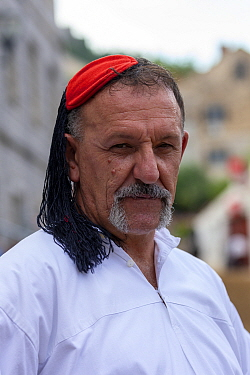 Man in traditional dress at Alka commemorations, portrait. Held on the first Sunday in August since 1715 the Alka commemorates the victory of Christians over Ottoman Turks. Inscribed on UNESCO Intangi...