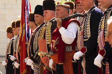 Men in traditional dress standing in row at Alka commemorations. Held on the first Sunday in August since 1715 the Alka commemorates the victory of Christians over Ottoman Turks. Inscribed on UNESCO I...
