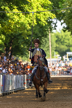 Man on horseback in traditional dress participating in Alka tournament, crowd spectating in background. Held on the first Sunday in August since 1715 the Alka commemorates the victory of Christians ov...