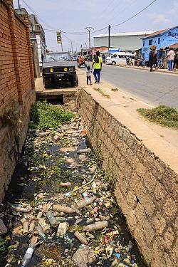 Plastic litter including bottles in gutter. Mandroseza, Antananarivo, Madagascar. 2019.