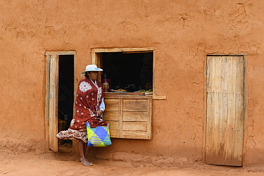 Woman standing outside shop. Central Madagascar. 2019.