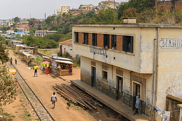 Mandroseza Railway Station, woman standing in doorway. Antananarivo, Madagascar. 2019.