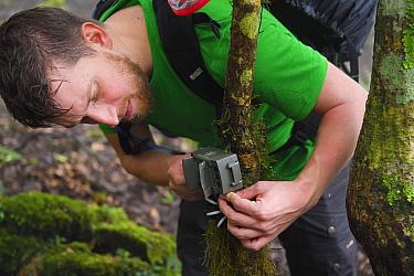 Photographer Fabian Muhlberger setting up trap cameras in Yushan National Park, Taiwan