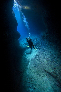 Diver in the Catherdral, a famous underwater cavern, Green Island, Taiwan.