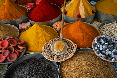 Various dyes, spices and seeds for sale at the market in Rissani, Morocco.