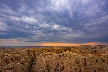 Storm clouds over badland formations, Badlands National Park, South Dakota, USA. August.